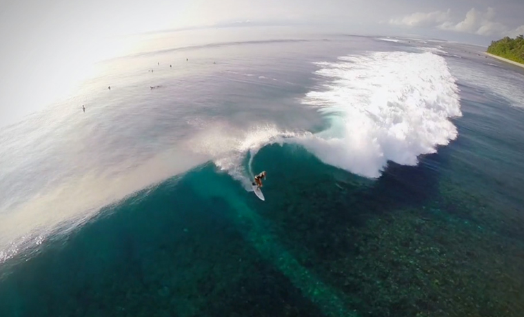 Aerial view of surfer on wave