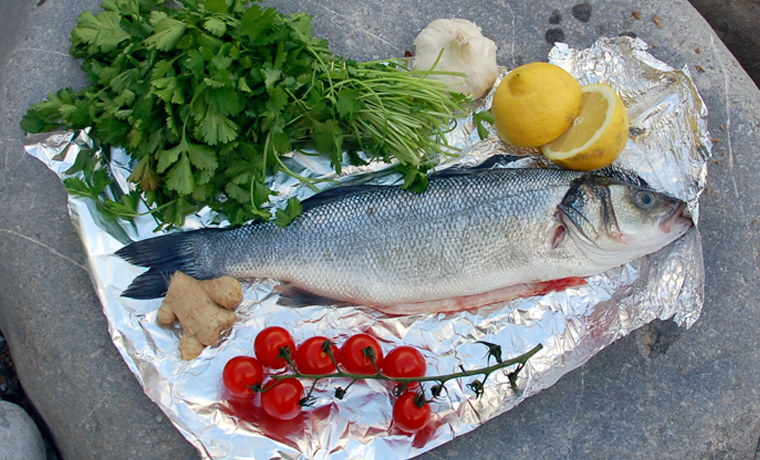 Fish on foil with ingredients