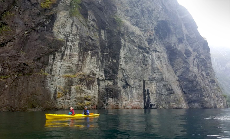 Sea kayaking in fjord