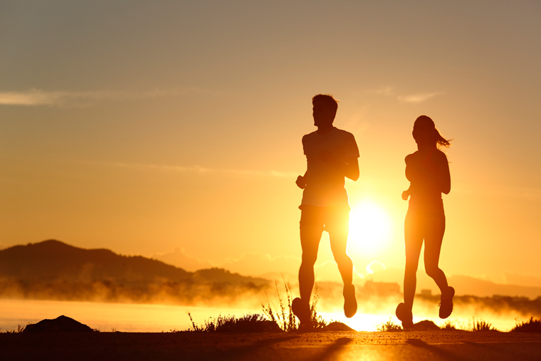 Silhouette of runners at sunrise