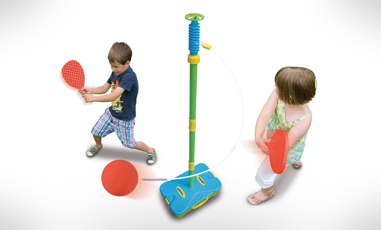 Two kids playing swingball