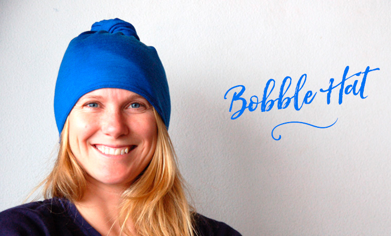 Woman wearing a Buff as a bobble hat