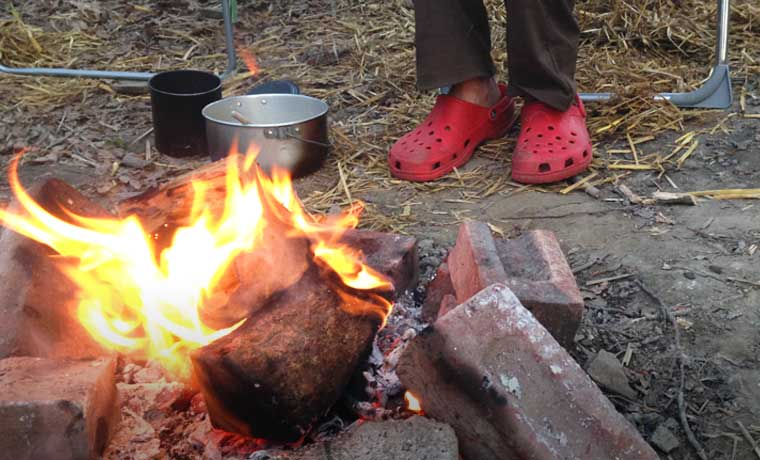 Camp shoes by a campfire