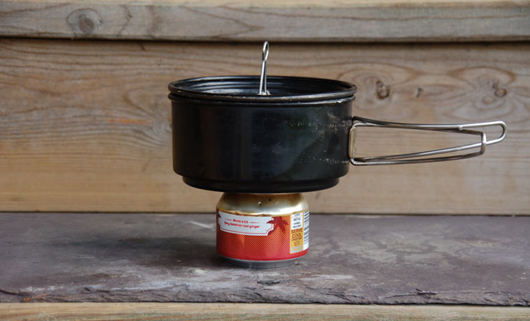Cooking pot on soda can stove