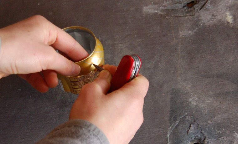 Making a hole in a soda can