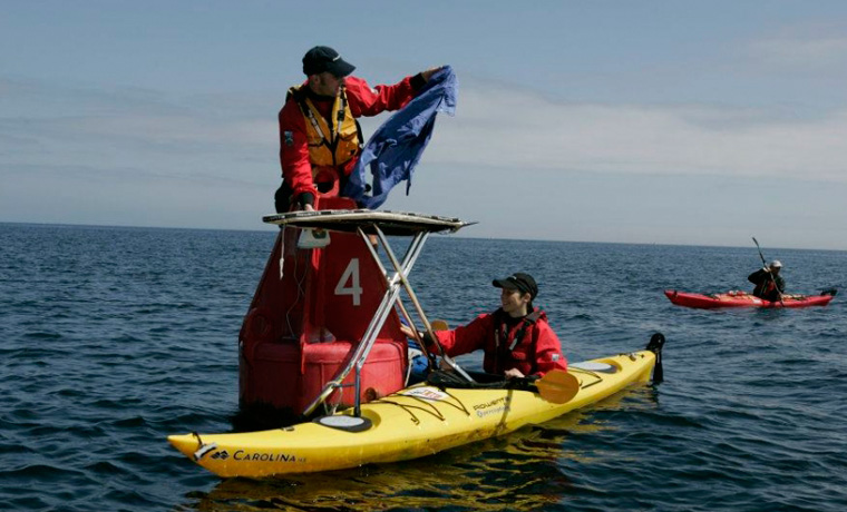 Extreme ironing sea kayaking