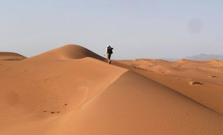 Walking on desert sand dunes