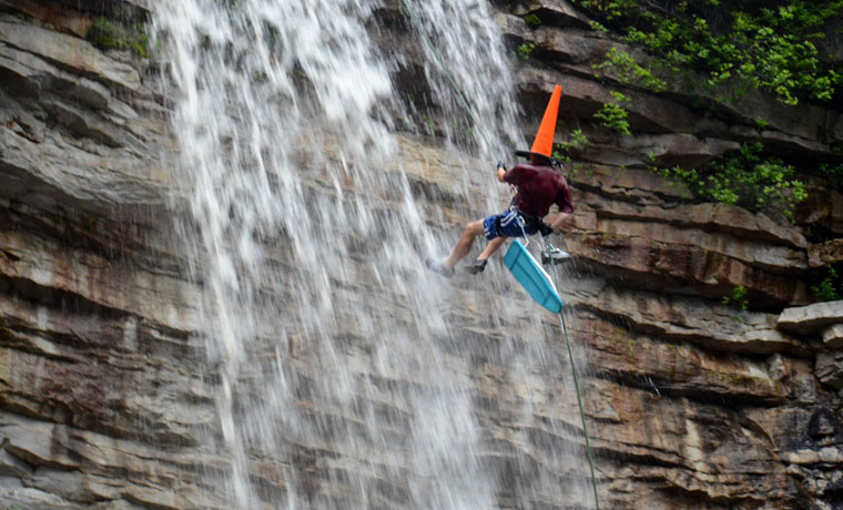Extreme ironing waterfall abseiler