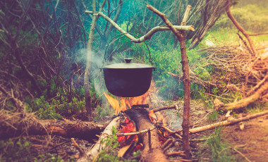 Camp cooking over campfire