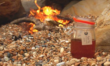 Apple pie moonshine on the beach by a campfire