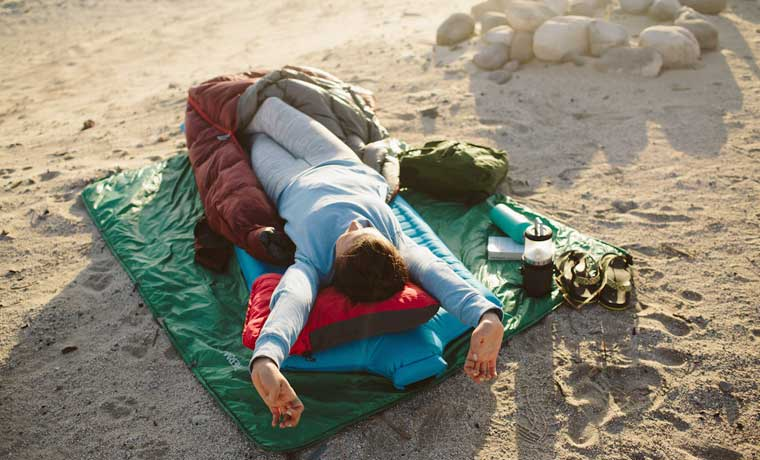 Sleeping on a camping pillow on the beach