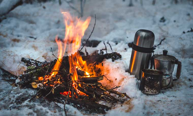 Winter campfire and hot drinks