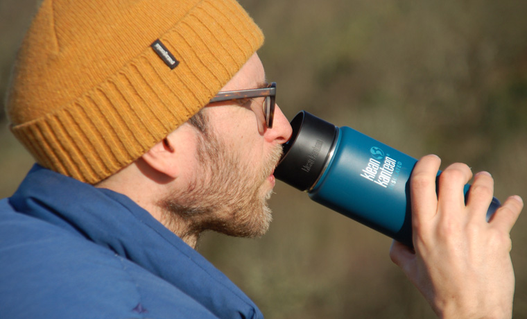 Man drinking out of Klean Kanteen cafe cap