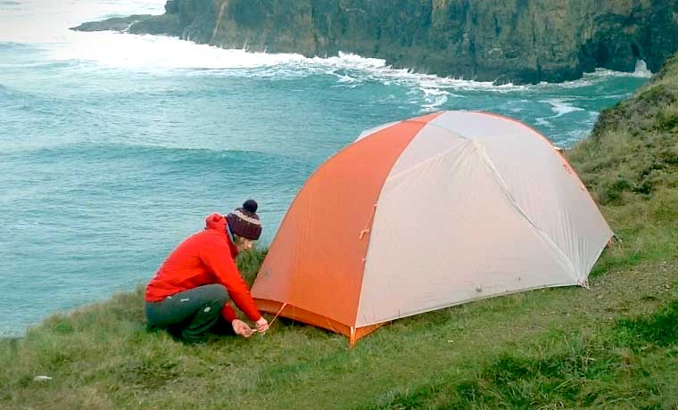 Securing a tent with pegs & How to Set up a Tent with Simple Tips on Where to Put It - Cool of ...