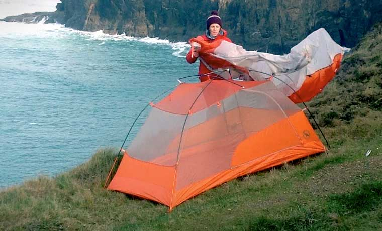 Putting the fly sheet on a tent