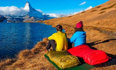 Wild camping with mountains and lake view