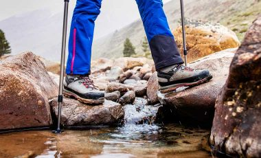Crossing a stream in the best hiking boots for men