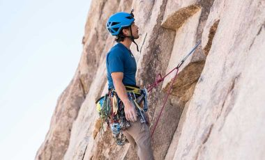 Climber wearing one of the best climbing harnesses