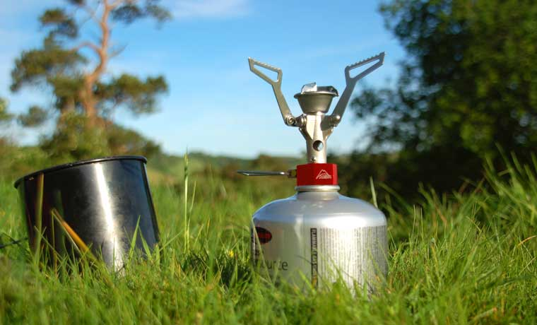 Stove on the grass with pot