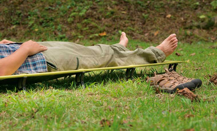 Man sleeping on one of the best camping cots
