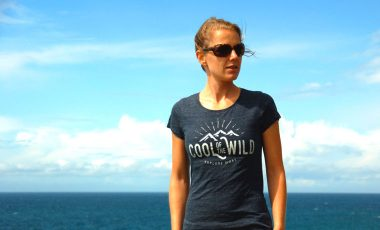 Woman in tshirt by the sea