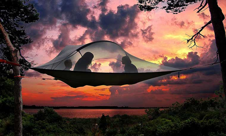 Suspended hammock tent at sunset