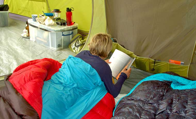 Woman reading in tent