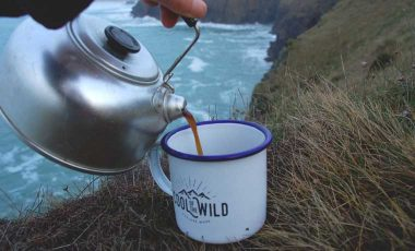 Pouring coffee from kettle