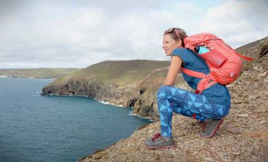 Woman on cliffs in hiking leggings