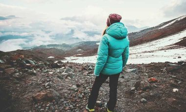 Woman wearing down jacket in mountains