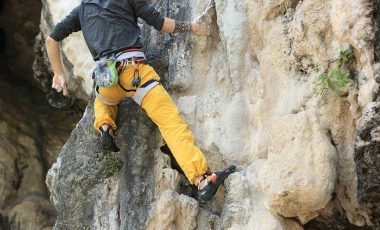 Man climbing on rock in the best climbing pants