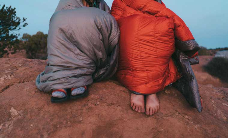 people wrapped in the best backpacking quilts