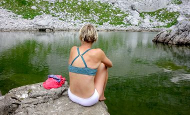 Woman by lake in best underwear for hiking