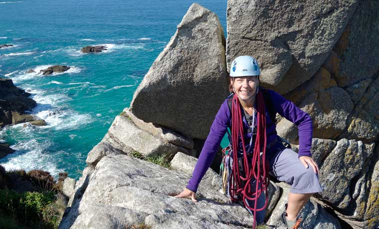 Woman wearing one of the best climbing helmets
