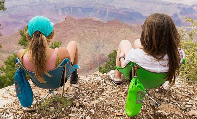 Women sitting on the best Backpacking chairs