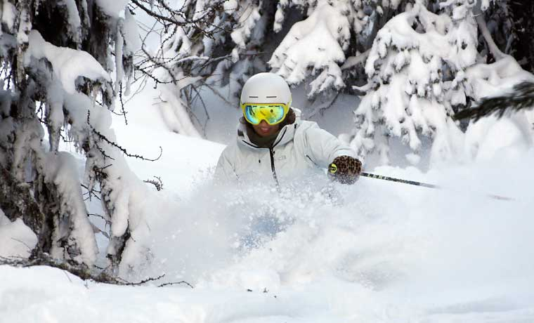 Woman skiing in a helmet