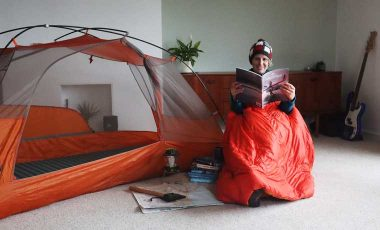 Woman camping indoors