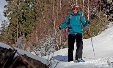 Woman standing in the snow on snowshoes
