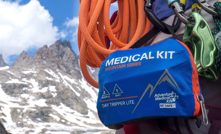 Climber carring first aid kit in mountains