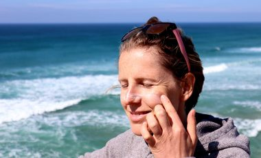 Woman applying eco-friendly sunscreen