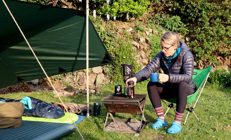 Woman making coffee camping