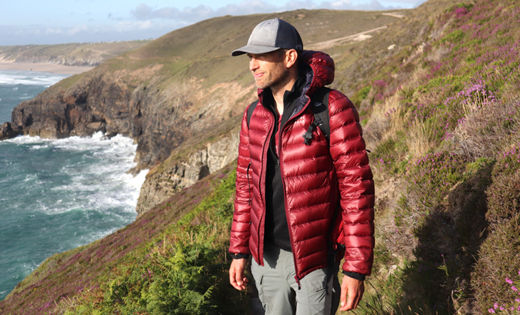 Man wearig Dark Peak jacket on cliff walk