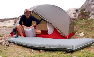 Woman inflating thermarest mattress
