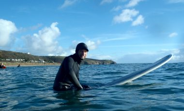 Surfer wearing wetsuit in the sea